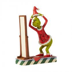Grinch Dressing in Santa Suit Figurine